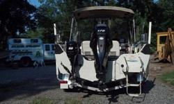 This is a top of the line aluminum boat and motor combination. The Crestliner Sportfish is made for big water with its high sides, sturdy construction and room interior. It is also a great family water sports boat. Storage compartments, rod lockers, liver
