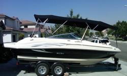2005 Sea Ray 200 Sundeck. This boat is 21 ft long and is in excellent condition. It has only been stored inside and never left in the water. It is a great family boat and is sleek looking in the water. It has a custom front bimini that zips into the back