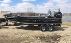 This is a 2013 Lund 2010 Pro Guide Tiller that is powered by a Mercury 200 Verado Supercharged 4 Stroke with Power Steering Tiller! This boat is equipped with the following options: Minn Kota 101 Terrova iPilot with iLink and US2 on a removable mount,