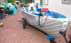 """This boat is ready to go fishing now! And it's wide with a 56"""" beam and is 12' it is very stable.The boat has been completely sanded down and """"rino"""" liner applied inside bottom with paint. minn cota 30# thrust motor almost new with 15 hp montgomery ward"""