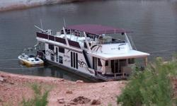 2000 Sumerset Houseboat 17x72 - $24,000 (Lake Powell - Hall's Crossing Slip)Star Chaser is a beautiful and extremely well maintained 17 feet wide x 72 feet long Sumerset Houseboat located in a covered slip in G dock at Hall's Crossing. When in the slip,