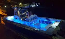 Eye catching 34 Fountain, Custom Paint Job. Powered by a pair of Mercury 300 Verados. Engine gauges include the digital Smart Craft vessel view. Analog gauges include water pressure and trim gauges. Push button engine start and stop. Just serviced a