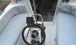 Locations Olympia, WashingtonPrice $13,000Great to sail and fast under power sips gas and cruises at 17 miles per hour with gear and crew.Water ballast allows boat to go from sailboat to power boat in less than 5 minutes. When drained weighs 2550 pounds