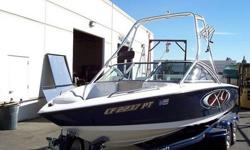 This gorgeous X-9 was has custom graphics, 350hp efi MCX engine with only 150 hours on it, tower, board racks, tower mirror, tower speakers, Perfect Pass Wakeboard Control, CD Stereo w/4 interior speakers, amp & sub-woofer, heater, shower, depth finder,