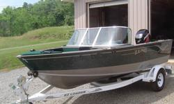 You are looking at a 2002 Lund Pro Sport that is in NEW condition. I am original owner and purchased new in May 2002 in Michigan, I transferred to Georgia in October 2002 and boat hasn't been in water 6 times since less than 50 hours total. Boat has been