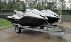 PAIR of Dealer Demo 2008 Honda Aquatrax F-15 PWC's on a Tandem Trailer with only 12 & 18 hours on them. Skis come with original warranty paperwork, warranty will start the day of the sale. Skis run very well, just installed new batteries and put fresh