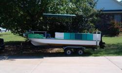 20 FOOT PARTY BOAT WITH TRAILER DUEL AXEL TROILLER MOTOR 35 HP. MERC. MOTOR IN VERY GOOD COND. FOR MORE INFO CALL 479 880 0308 .WILLIAM TURNER.