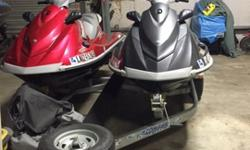 VX Deluxe Cruiser models, 1052 cc. These 2 jet skis have been covered and kept inside a shop and only have 52 hours on each. Bought brand new batteries for both skis last summer. They have covers and 5 year warranty. They have never been in salt water and