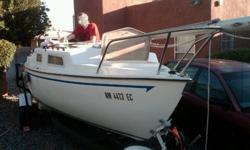 The San Juan 21 sailboat is in fair condition, it comes with it's own custom trailer with a 2in ball hitch. Inside the fiberglass interior there are two quarter berths, and a small V-berth. Large cockpit for its size, this boat was designed to be a fast,