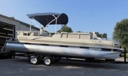 She measures in at 22 feet deck length with 22 feet by 25? diameter pontoons. The deck width is 8 feet and she weighs 1,730 pounds with furniture installed, and can carry up to 12 people.PerformanceI tested the Windjammer 22 RC on an inland lake in