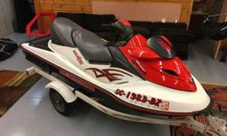 Runs Well, Used in Freshwater Only, SuperCharged, Stored Inside, Includes ShoreLandr Trailer: New Tires and 1 Axle. Seats Recently Recovered. Includes: 2 Wake Boards, Tube, 2 Tow Lines, Extra Spark Plugs, 4 Life Jackets, Less than 1 Year Old Cover, Spark
