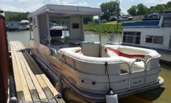 the motor is a mercury 200 saltwater edition (it has never been in saltwater though), it has a 4 blade stainless steel prop, the boat is showing 104 hours of use. it comes with a stainless steel propane grill, anchor, seat covers,Keywords: Boat Broker,