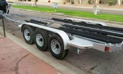 TRI AXEL BOAT TRAILER 8 LOG 7000LB EACH AXLE TOTAL OF 35FEET ARIZONA PERMANENT PLATE , BOAT / YACHT TRAILER ,TRIPLE AXEL  ALL LIGHTS LEDEVERYTHING FUNCTIONS PERFECTLY SIERG BRRAKS WORKS EXCELLENT NEW TIRES .PLEASE CALL 602 358 XXXX