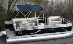 We are selling this new 20 ft Grand Island rear entry cruise G series low to make room for the 2015 models. This new 20 ft pontoon boat is made by us here in Minnesota by us. It is a striped down model that comes with no options. You get the furniture you