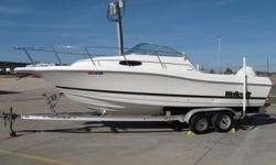 You are looking at 2000 WELLCRAFT 24 WALKAROUND BOAT WITH 225 HP FICHT RAM INJECT EVINRUDE MOTOR! Motor has been checked and is in good mechanical condition. MOTOR HAS ONLY 63 HOURS!! Year of the motor is 2002. Compression check has been done, and it