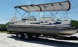 Mercury Bigfoot EFI outboard with power trim powers this pontoon boat. Features include: color coordinated bimini top, snap-on mooring cover, Humminbird PiranhaMax 15 depth/fish finder, fiberglass console w/windscreen, Boss AM/FM stereo w/weather guard