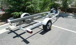 Zieman boat trailer to transport a Dinghy, lightweight boat up to 13ft. or two Jet Skies. In like new condition. Included are a brand new spare wheel and tire, wheel lock, tongue lock, and solid stainless steel ball hitch lock. This trailer has only been